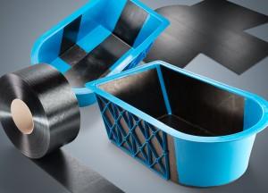 Das erste Tape-Demonstrationsbauteil der BASF auf Basis ihres neuen Produkt- und Servicepakets Ultracom für die Herstellung von Faserverbundbauteilen ist an einen Batterieträger angelehnt. (Foto: BASF)