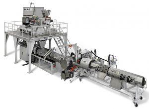 Anlagenbeispiel für eine integrierte Recycling-/Compoundieranlage, bestehend aus konischem MAS-Gleichlauf-Doppelschneckenextruder, CDF-Schmelzefilter und Einschnecken-Extruder mit Entgasung. (Foto: MAS)