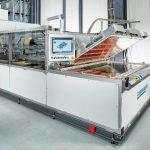 Industrieanlage Fibercon: Prozesstechnik zur Konsolidierung von thermoplastischen Hochleistungsfaserverbunden (UD-Tapes) auf der Basis der am Fraunhofer ICT entwickelten strahlungsinduzierten Vakuumkonsolidierung. (Foto: Fraunhofer ICT)