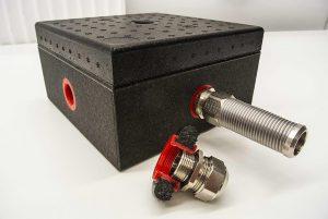 K-Fix besteht aus einem schwarzen Grundkörper aus expandiertem Polypropylen (EPP), in dem sich das eingespritzte Befestigungselement befindet. (Foto: Krallmann)