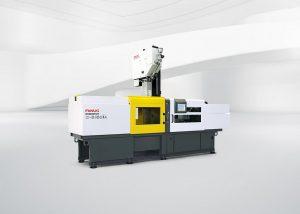 Kompakte Produktionszelle aus einer Roboshot alpha-S150iA und vertikaler zweiter Spritzeinheit SI-20A für die Mehrkomponenten-Spritzgießtechnik. (Foto: Fanuc)