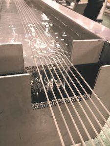 Die ips-LFT HP Pultrusionsanlage steht für die effiziente Herstellung von langfaserverstärkten Thermoplasten. (Foto: ips)